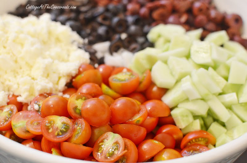 cherry tomatoes and other ingredients in orzo salad