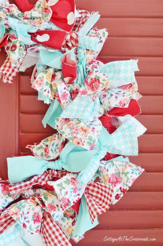 red. white, and aqua fabrics used in a rag wreath