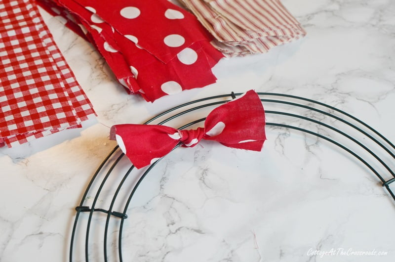 Wire wreath form with one fabric stip