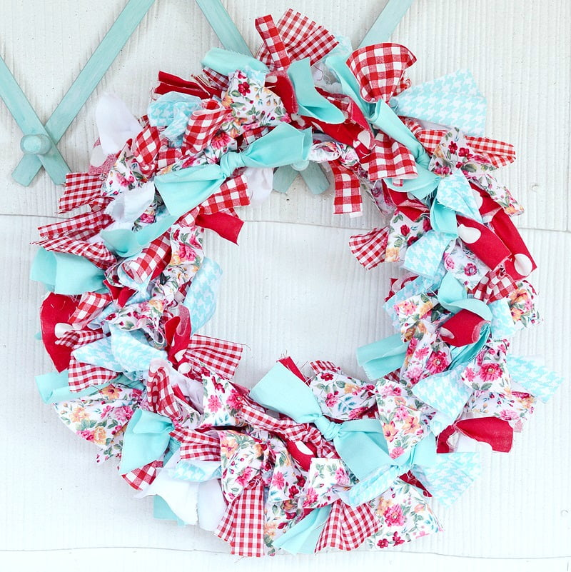cutting strips of fabric to make a rag wreath