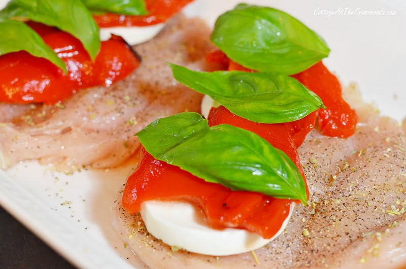 fresh basil leaves, roasted red peppers, and fresh mozzarella on chicken breasts