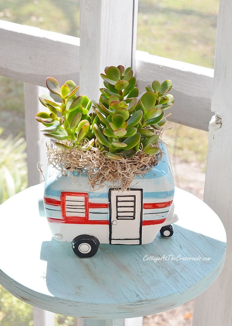 vintage camper planter on a fall front porch