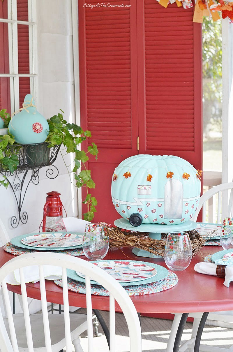 fall front porch with a camping theme tablescape