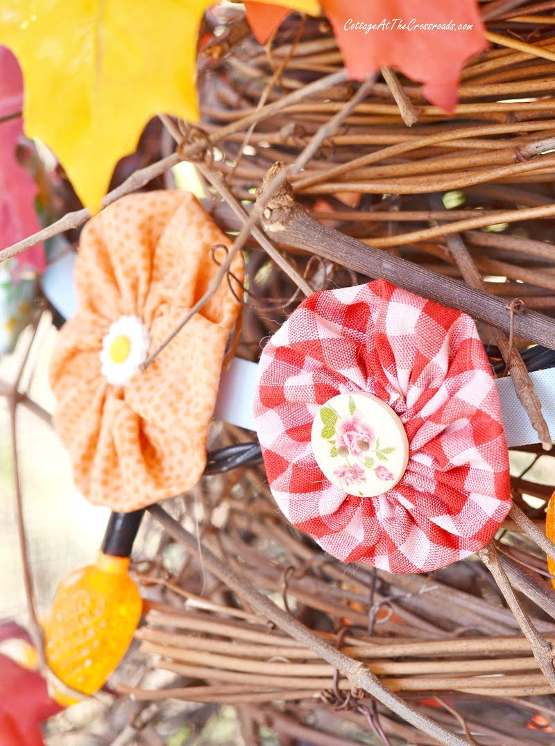 fabric yo-yo garland on a grapevine tree