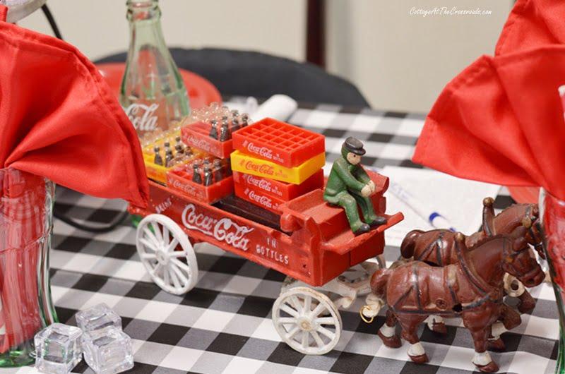 vintage horse drawn wagon carrying cases of Coca-Cola