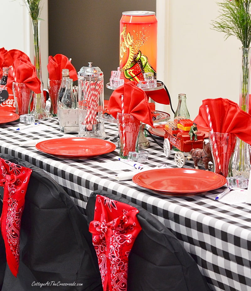 Coca-Cola tablescape with red bandanas on the chair covers