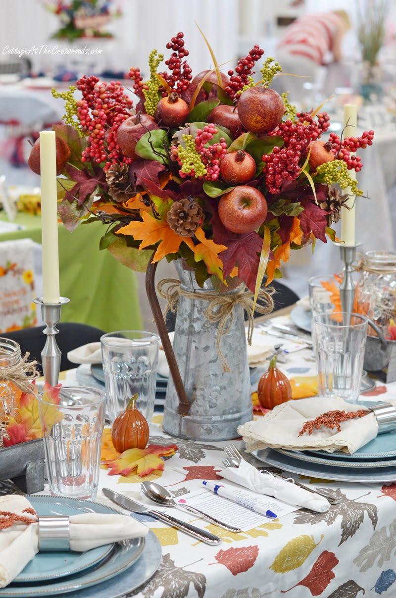 floral fall centerpiece in a galvanized container