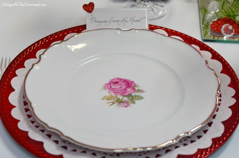 vintage china with a pink rose in the center