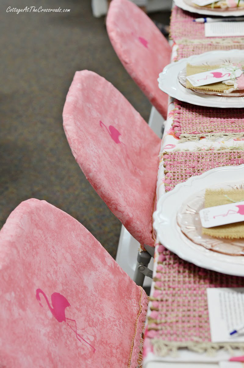 chair covers with stenciled flamingos
