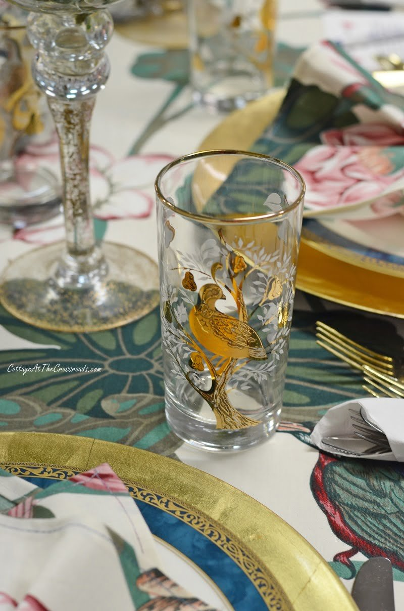 gold bird decoration on glassware