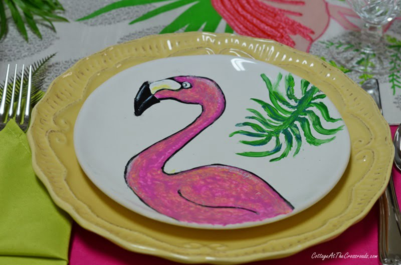painted flamingo plates used in a tablescape