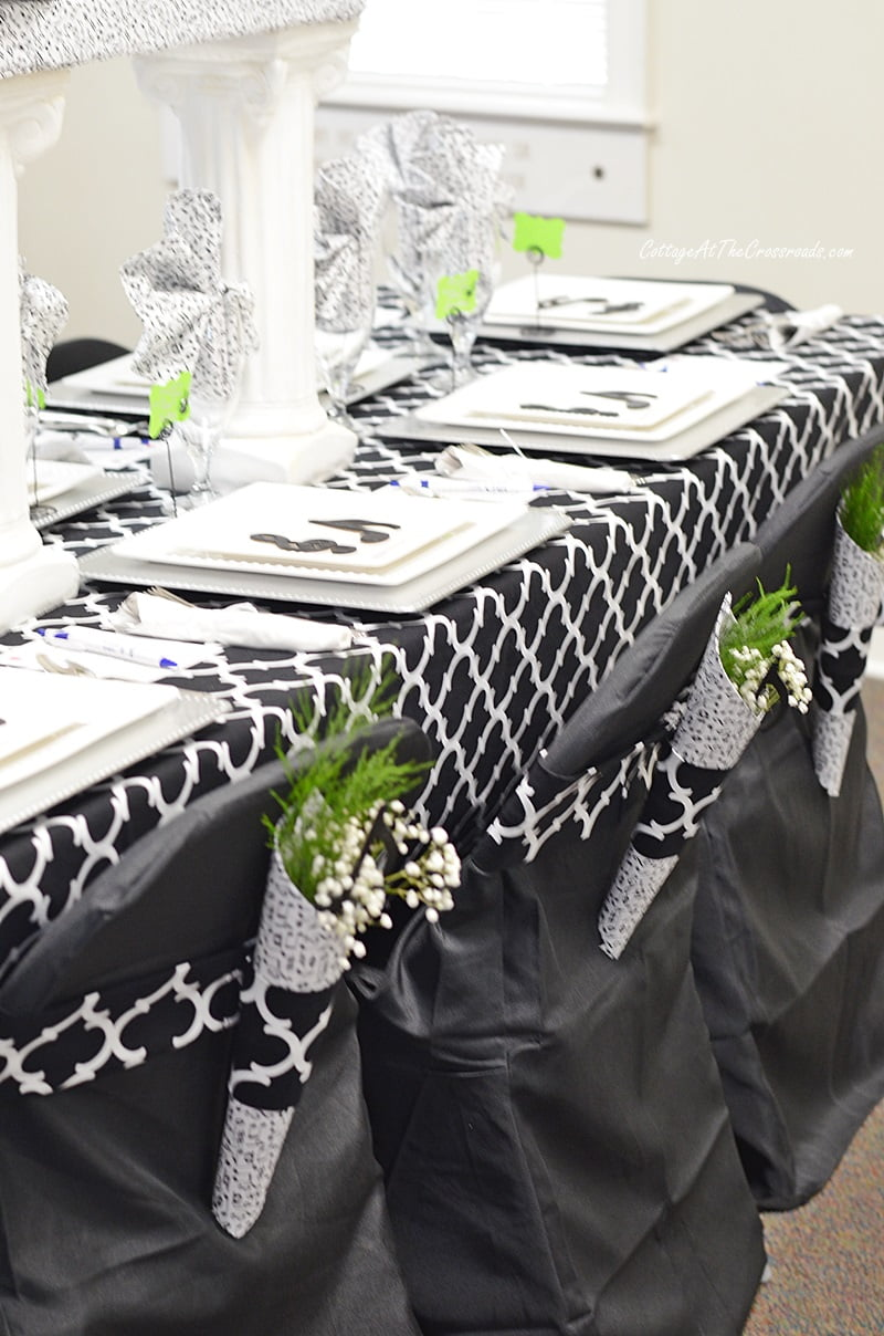black and white tablescape with a music theme