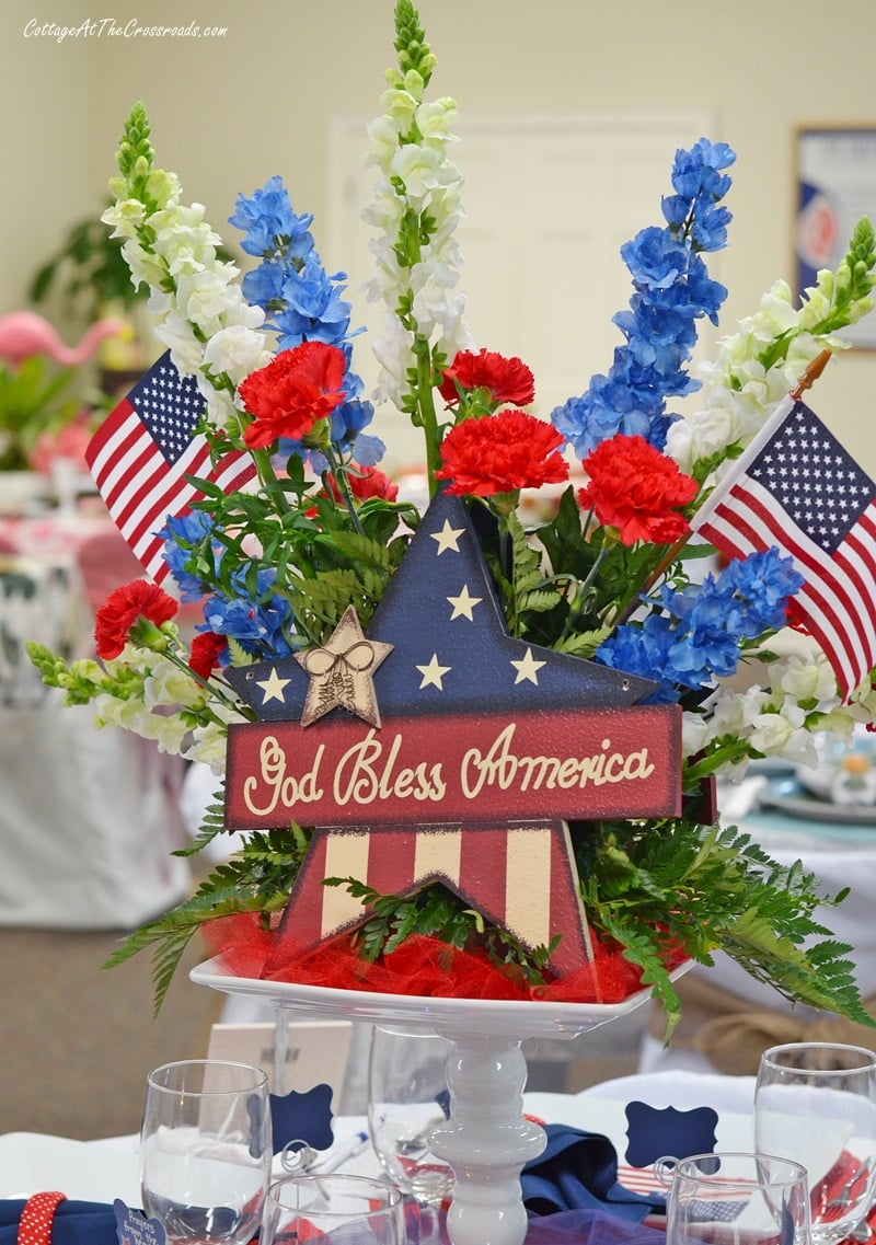 patriotic centerpiece with red, white, and blue flowers