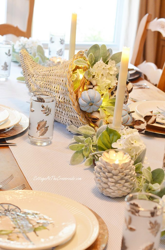 Thanksgiving tablescape with a cornucopia centerpiece
