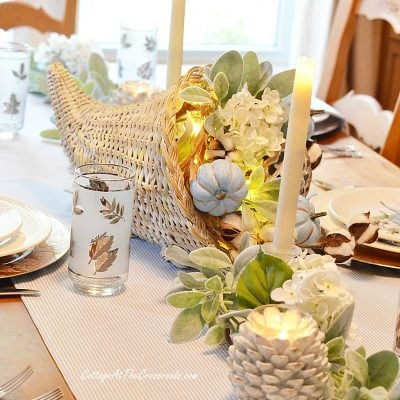 Thanksgiving tablescape with cornucopia centerpiece