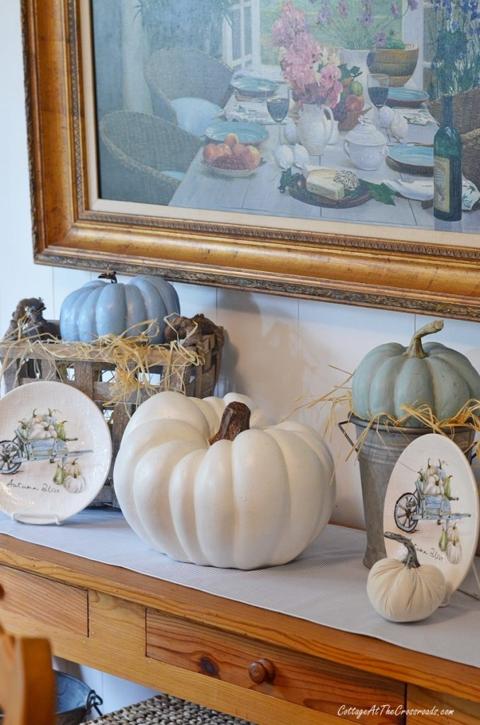 Thanksgiving vignette with pumpkins and plates