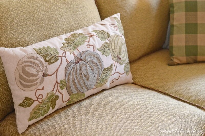 fall pillow with a blue pumpkin