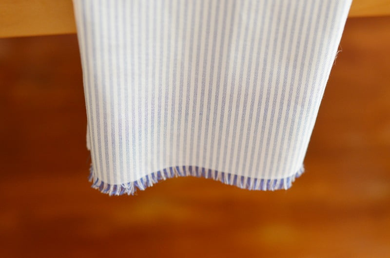 blue and white napkins with fringed edges