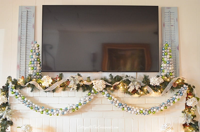 ornament garland on a Christmas mantel