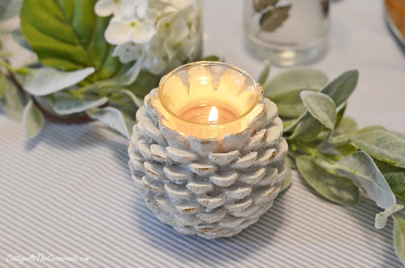 pine cone candle holders used on a Thanksgiving table