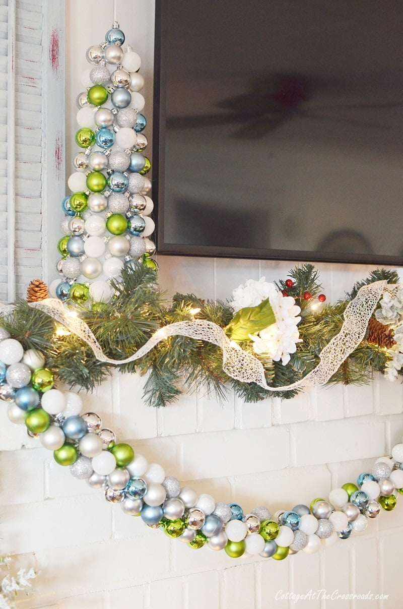 matching topiary and garland made with small ornament balls