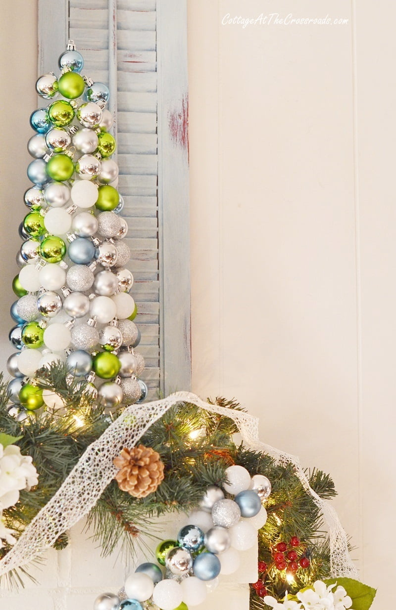 ornament ball topiary used on a Christmas mantel