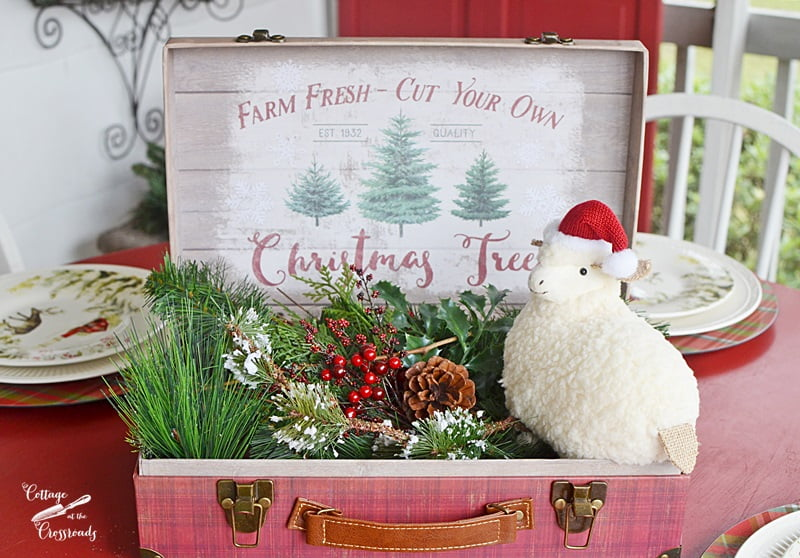 farmhouse centerpiece on a Christmas front porch