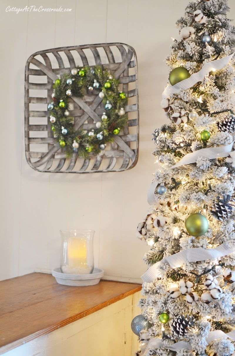 ornament wreath beside a Christmas tree