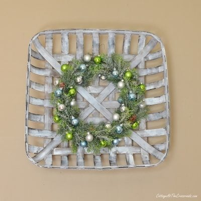 Christmas ornament wreath in a tobacco basket