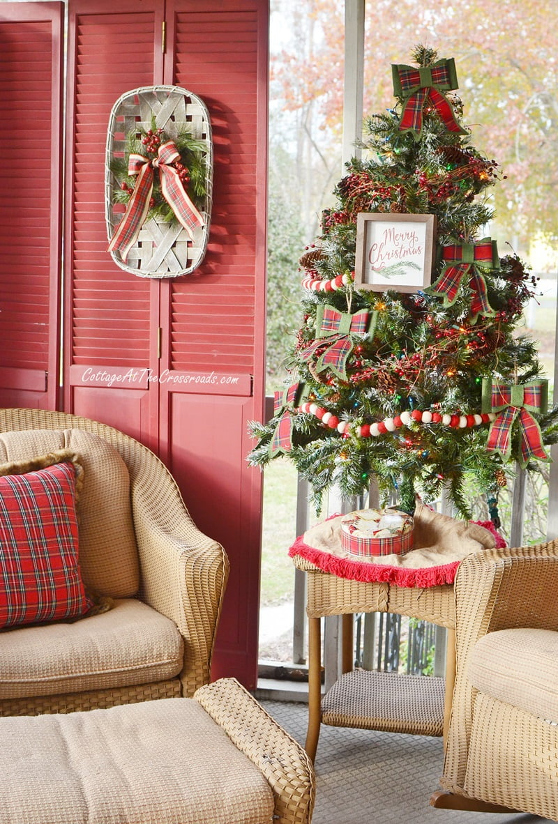 Christmas front porch decorated with traditional reds and greens