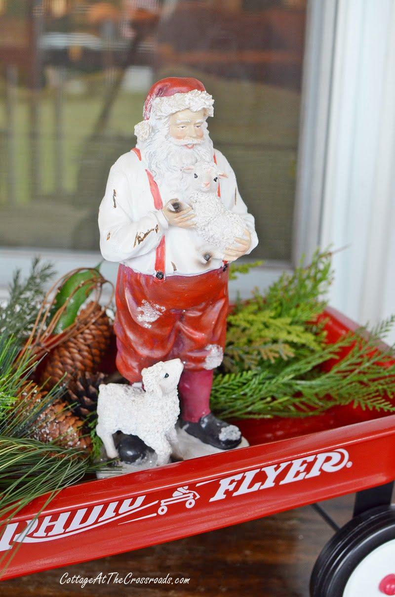 Farmhouse Santa on a Christmas front porch