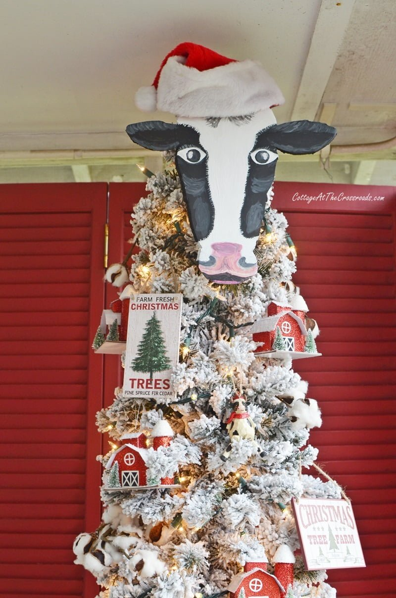 Christmas tree with a cow head topper