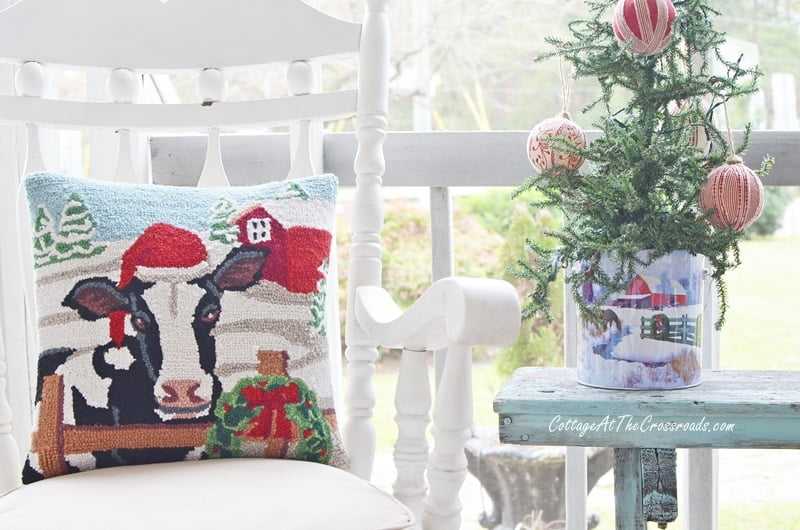 cow pillow on a Christmas front porch
