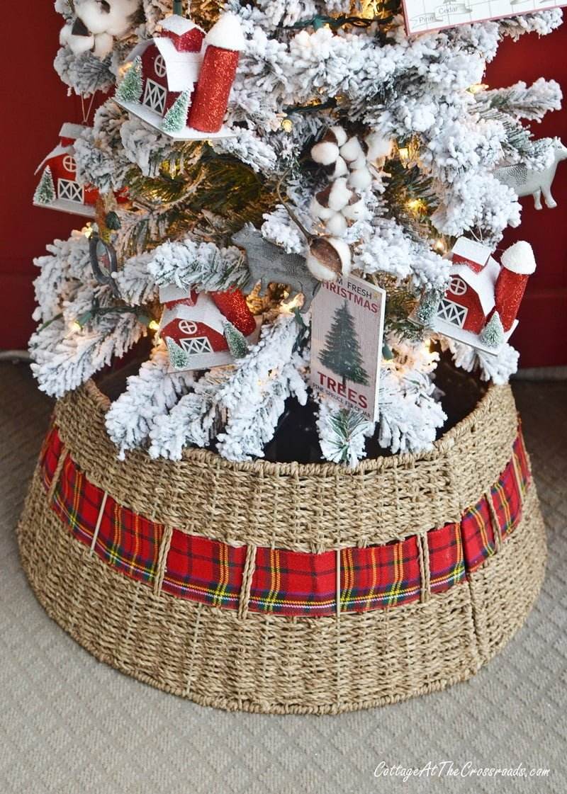 tree collar with plaid ribbon on a Christmas front porch