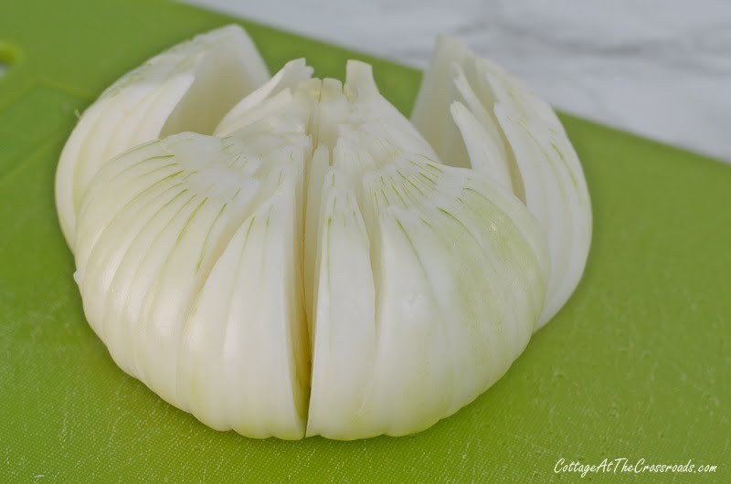 cutting an onion to make a blooming onion