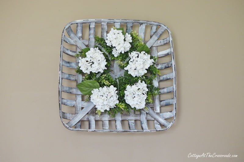farmhouse wreath in a tobacco basket