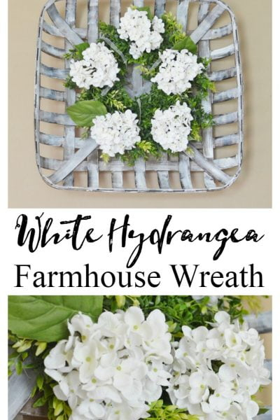 white hydrangea farmhouse wreath in a tobacco basket