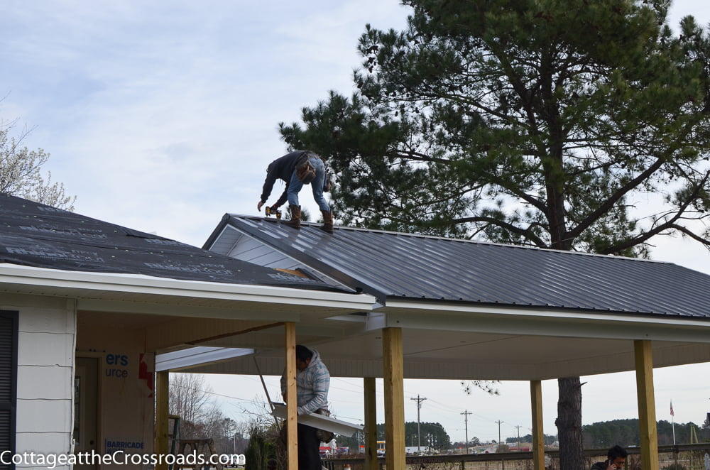 roofer installing a metal roof