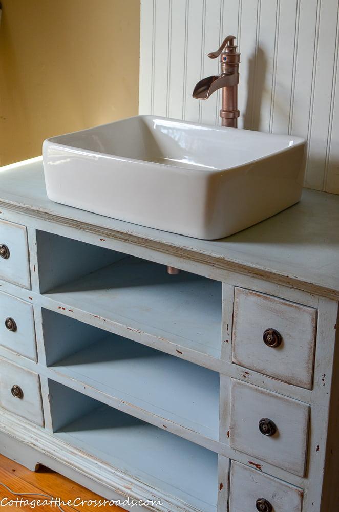 repurposed vanity with a vessel sink