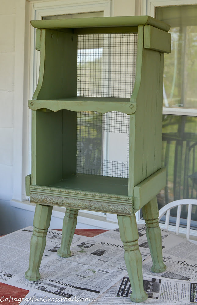 green painted cottage style magazine rack
