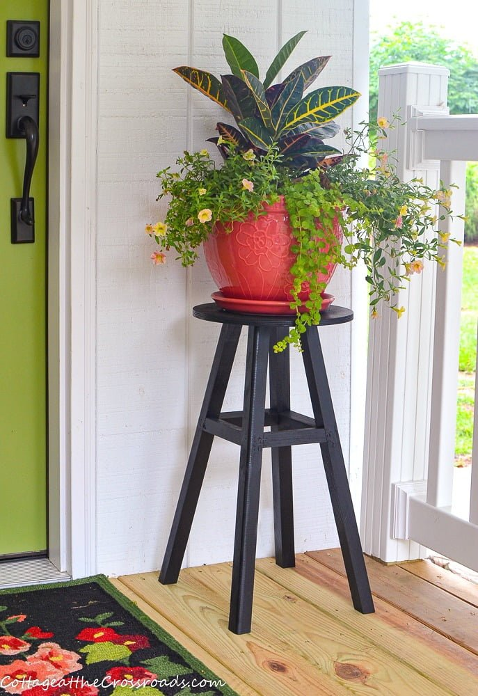 refurbished stool used as a plant stand