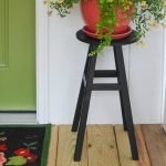 refurbished wooden stool used as a planter