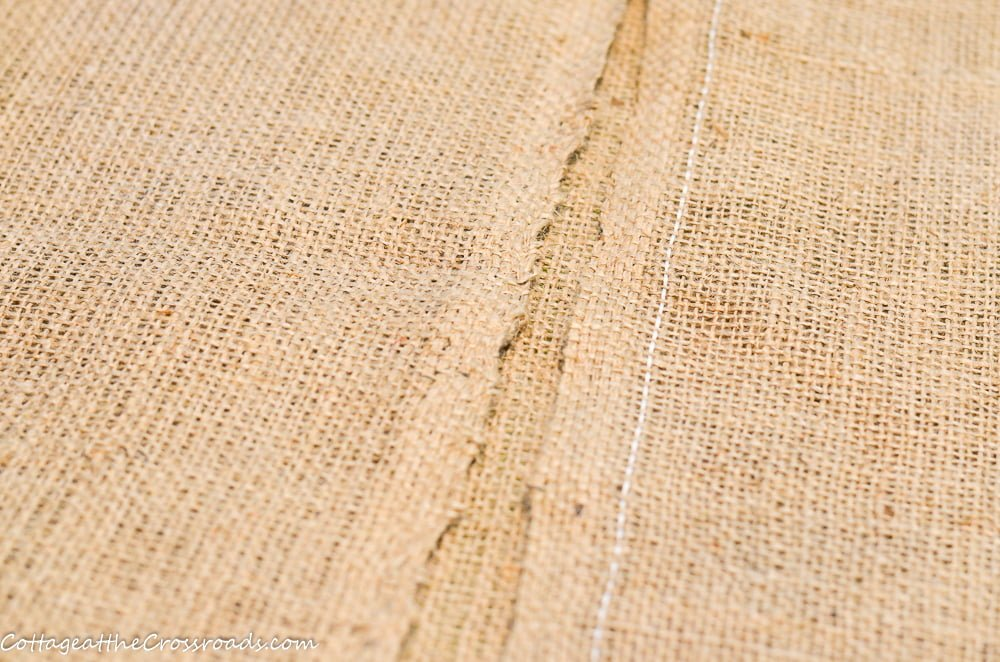 burlap fabric folded in half to make a seed sack