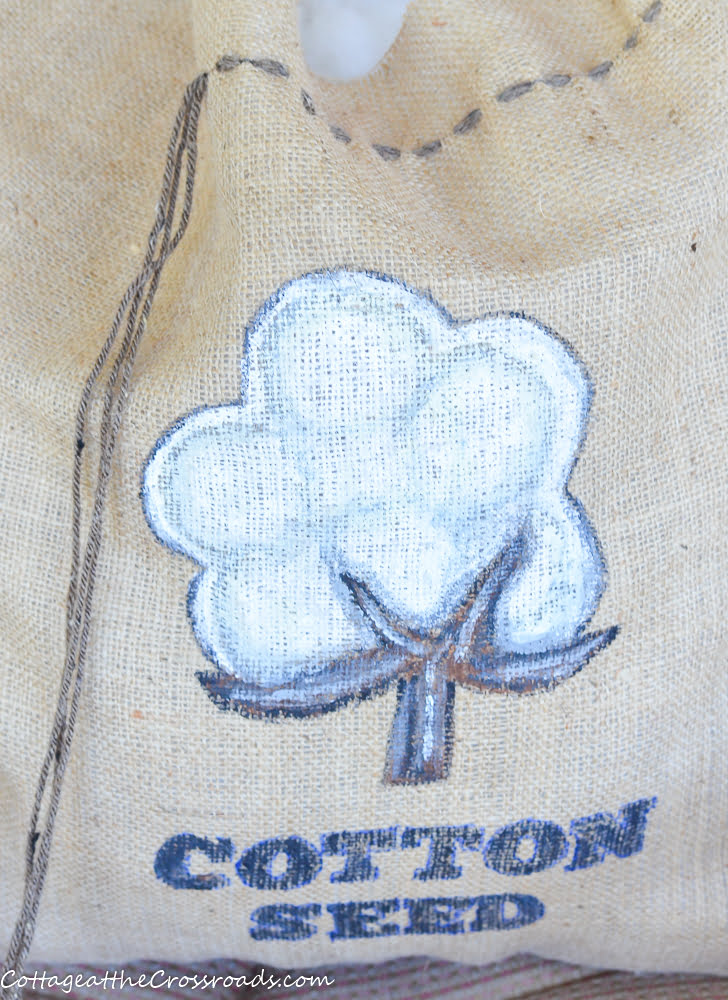 painted cotton boll on a cotton seed sack