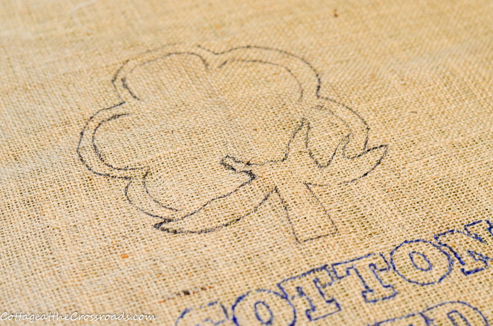 traced cotton boll and words on a cotton seed sack