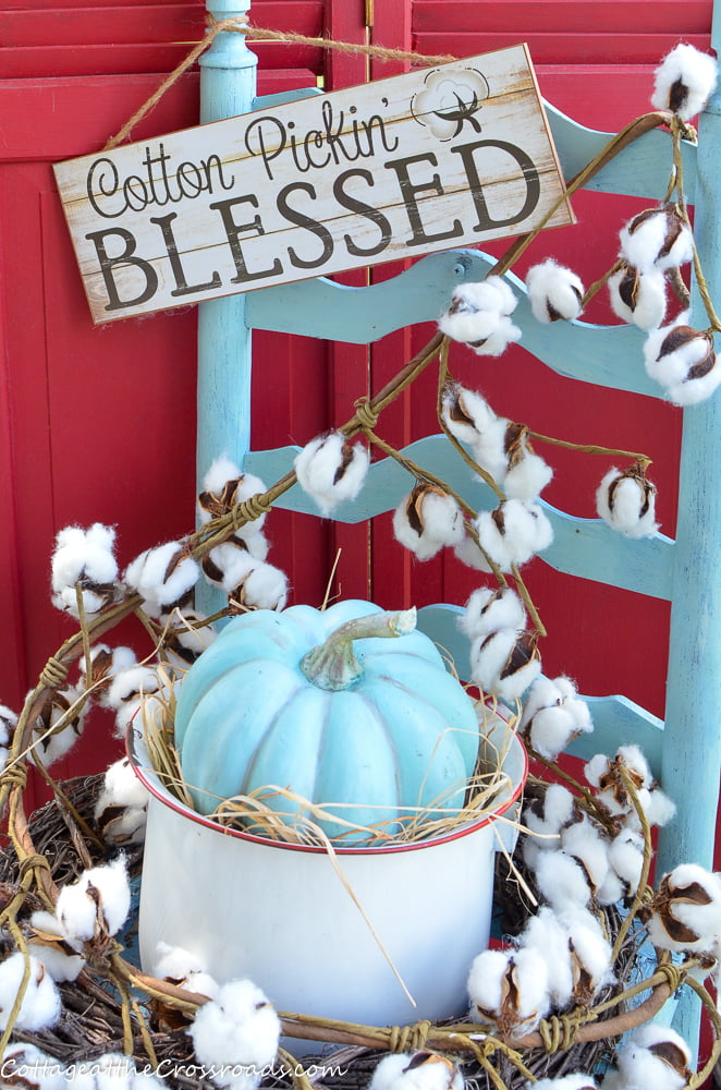 old chair decorated with cotton and a Cotton Pickin' Blessed sign