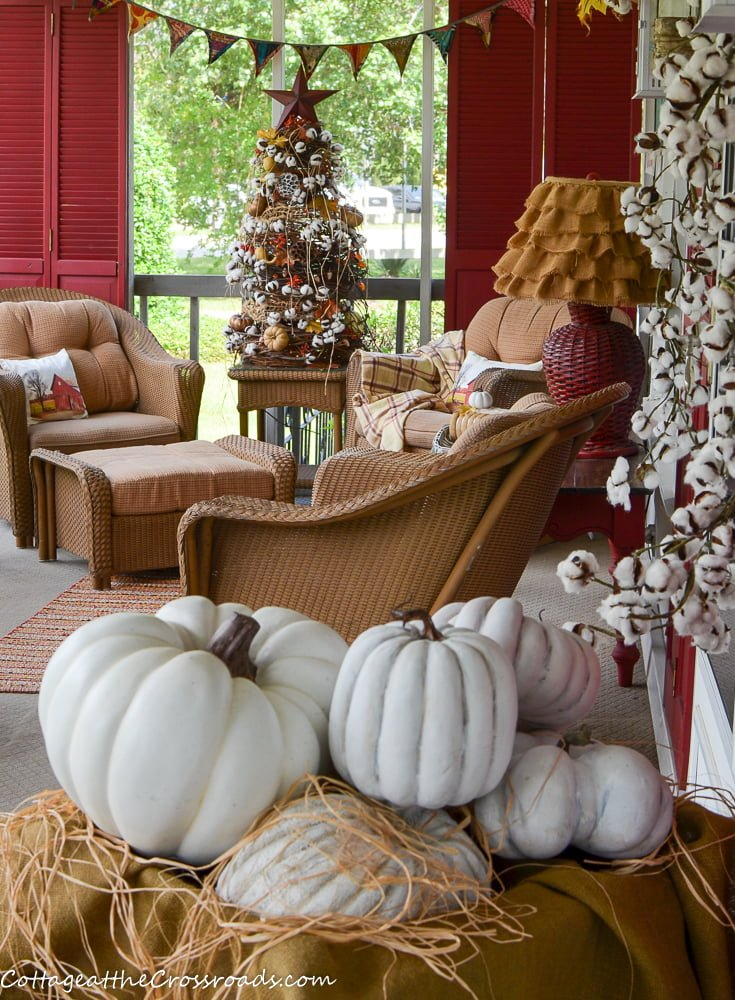 fall front porch decorated with a cotton theme