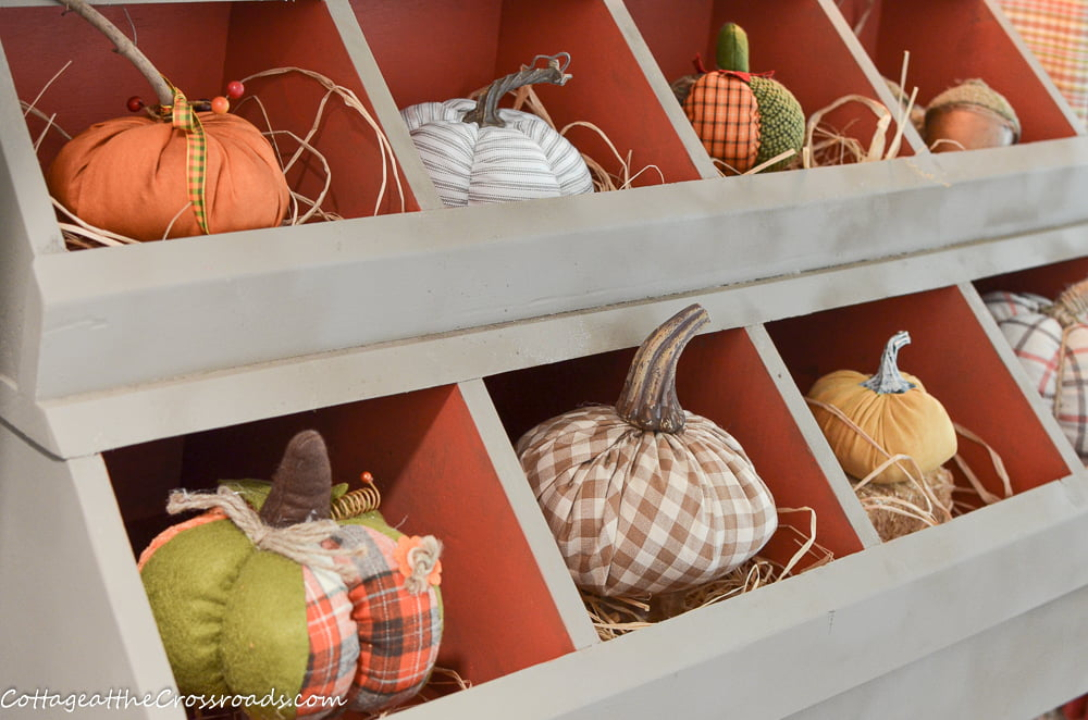 cubby in mudroom filled with pumpkins