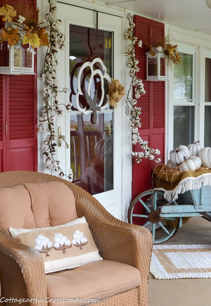 country cottage farmhouse porch decorated with a cotton theme