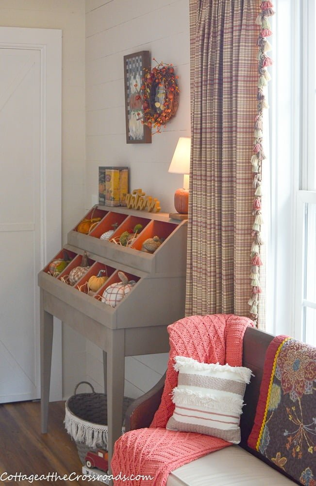 fall decorated cubby in the mudroom/laundry